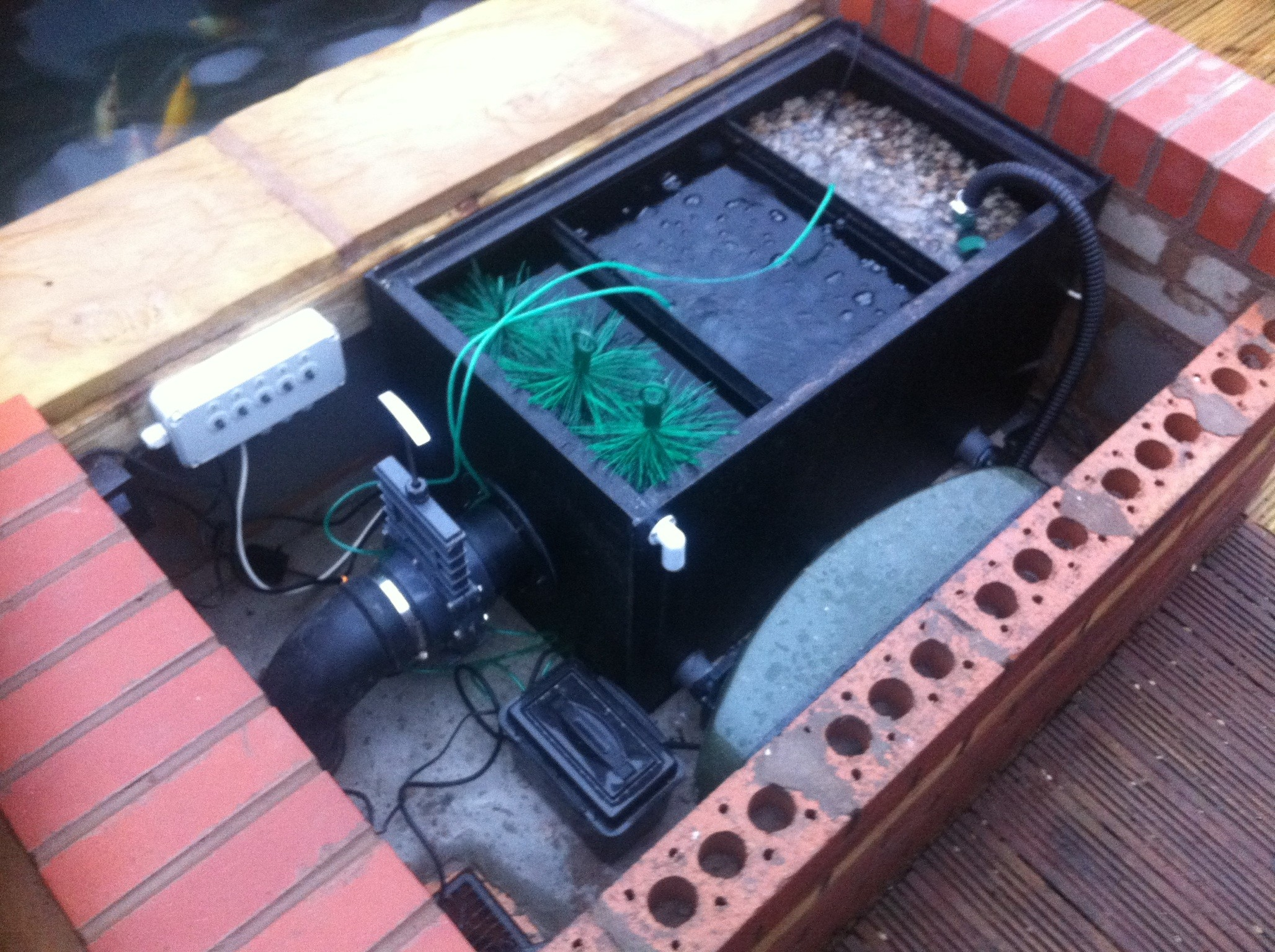 Koi pond specialists parkes quality landscaping services ltd for Koi pond pump system