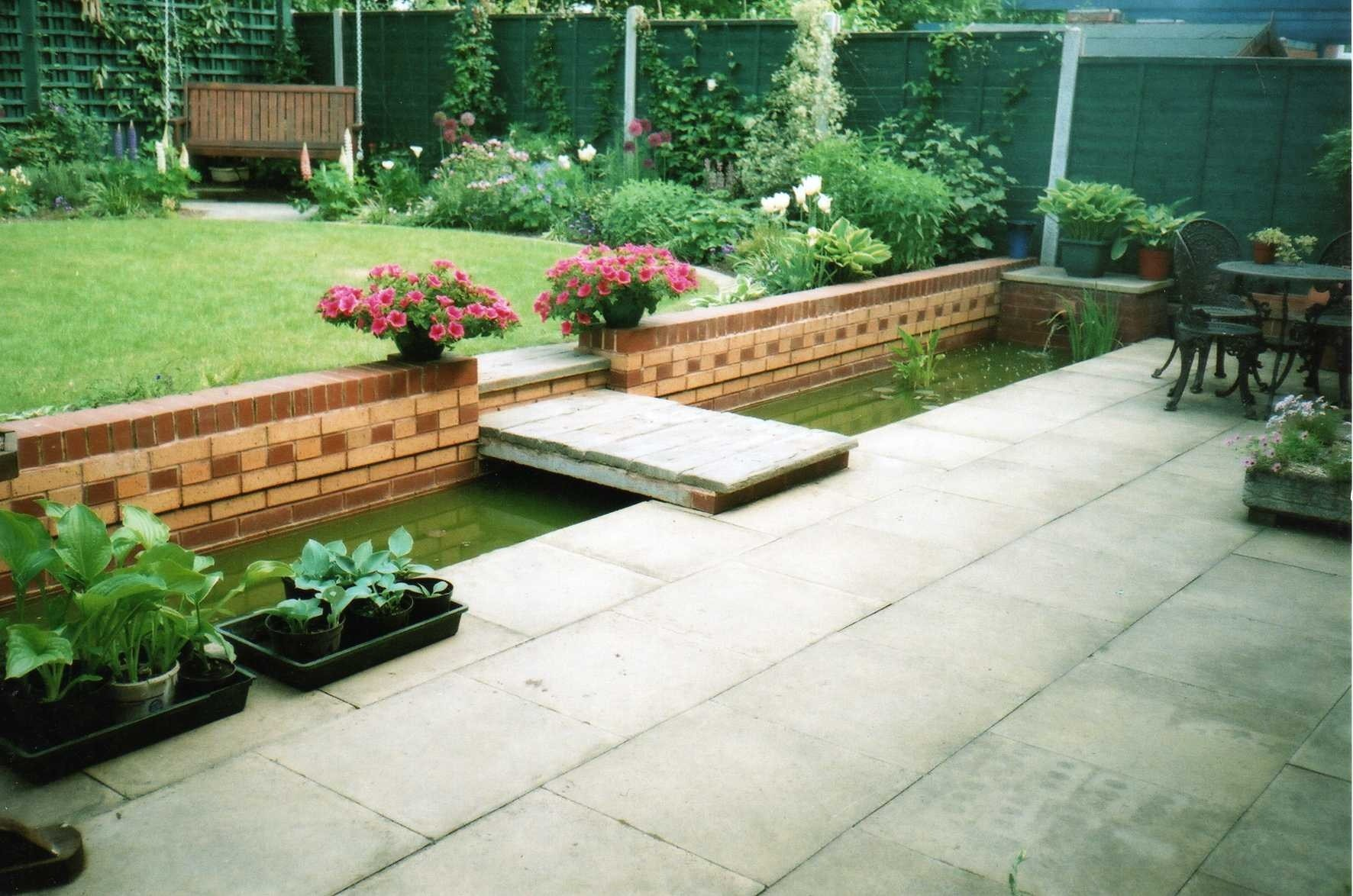 Koi pond specialists parkes quality landscaping services ltd for Garden decking with pond